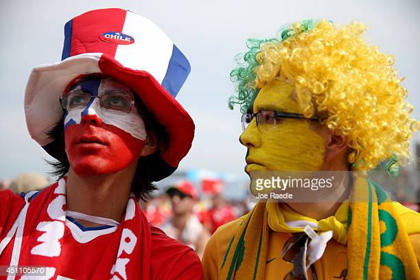 Chile and Brazil soccer fans watch as Chile takes on the Netherlands on a screen setup at the FIFA Fan Fest on Copacabana beach June 23 2014 in Rio...