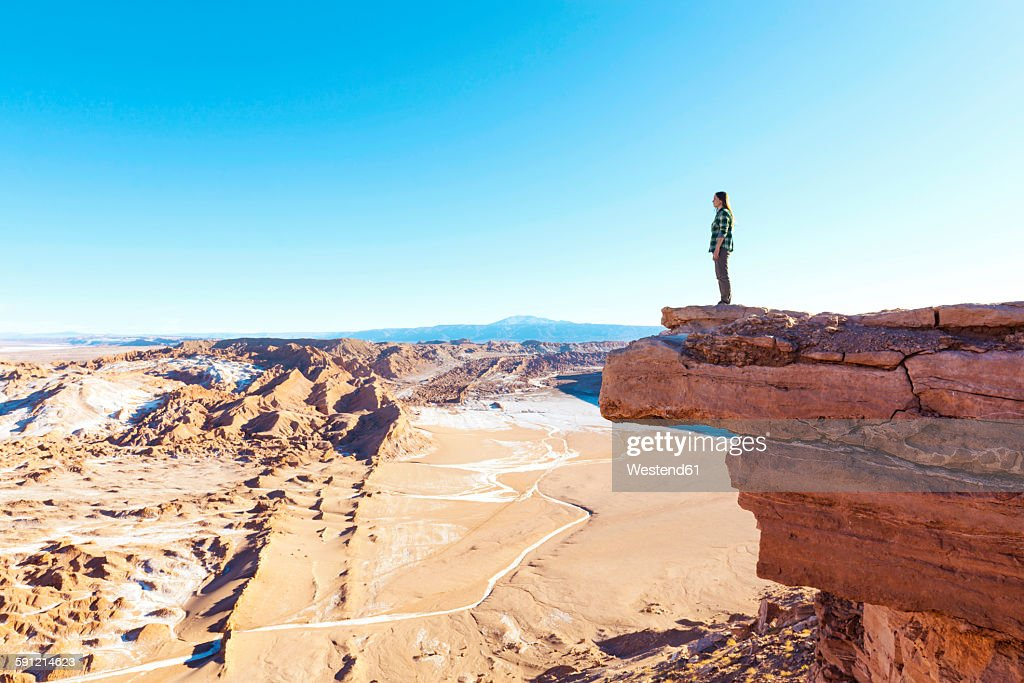 Chile, Atacama Desert, woman standing on a cliff looking at view : Stock Photo