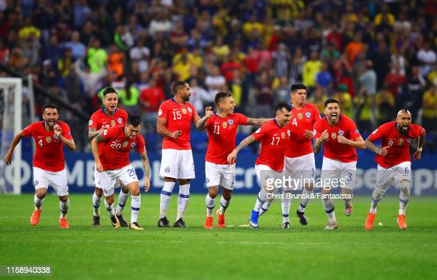 Chile celebrate after winning the penalty shoot-out following the Copa America Brazil 2019 quarterfinal match between Colombia and Chile at Arena...