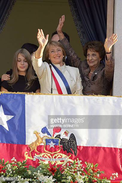 Chile's President Michelle Bachelet waves to people from the balcony of La Moneda palace in Santiago with her daughter Sofia her mother Angela Jeria...