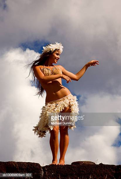 Chile, Easter Island, Young woman dancing, low angle view