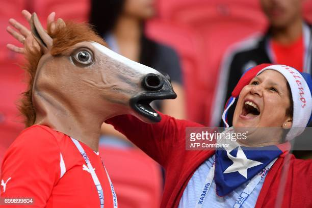 A Chile fan reacts as she waits for the start of the 2017 Confederations Cup group B football match between Germany and Chile at the Kazan Arena...