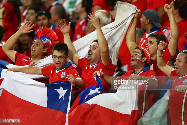 Chile fans cheer during the 2014 FIFA World Cup Brazil Group B match between Chile and Australia at Arena Pantanal on June 13 2014 in Cuiaba Brazil