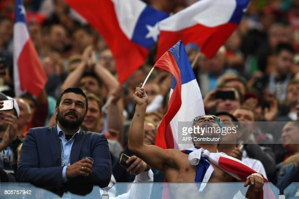 Chile fans cheer during the 2017 Confederations Cup final football match between Chile and Germany at the Saint Petersburg Stadium in Saint...