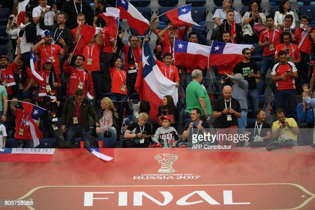 Chile fans wave their national flag during the 2017 Confederations Cup final football match between Chile and Germany at the Saint Petersburg Stadium...