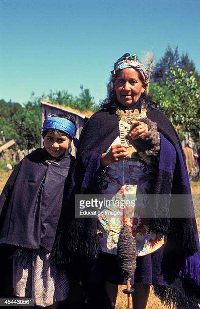 Chile Lake District Mapuche Indian Woman In Traditional Clothing With Child