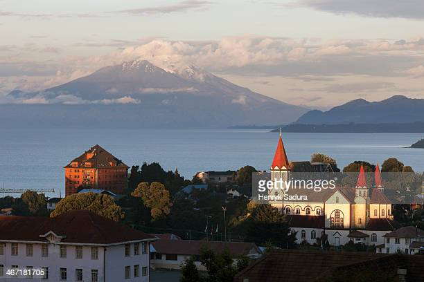 Chile, Lake District, Puerto Varas, Town skyline with volcano in background