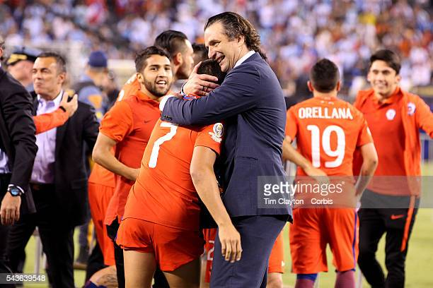 Chile national football team manager Juan Antonio Pizzi hugs Alexis Sanchez of Chile after their sides penalty shoot out victory during the Argentina...
