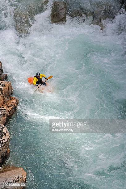 Chile, near Futaleufu, Rio Azul, man kayaking in white water