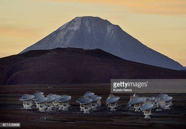 PLATEAU Chile Photo taken at dusk on March 15 shows some of the Alma telescope antennas set up on the Atacama Plateau Chile against the backdrop of...