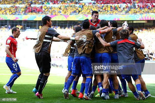 Chile players celebrates their team's first goal during the 2014 FIFA World Cup Brazil Round of 16 match between Brazil and Chile at Estadio Mineirao...