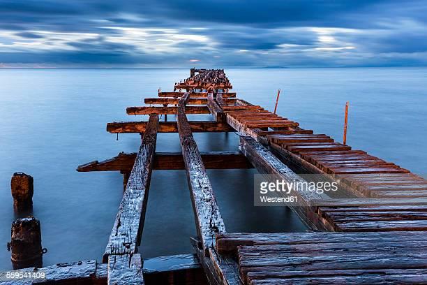 Chile, Punta Arenas, broken old jetty at sunset