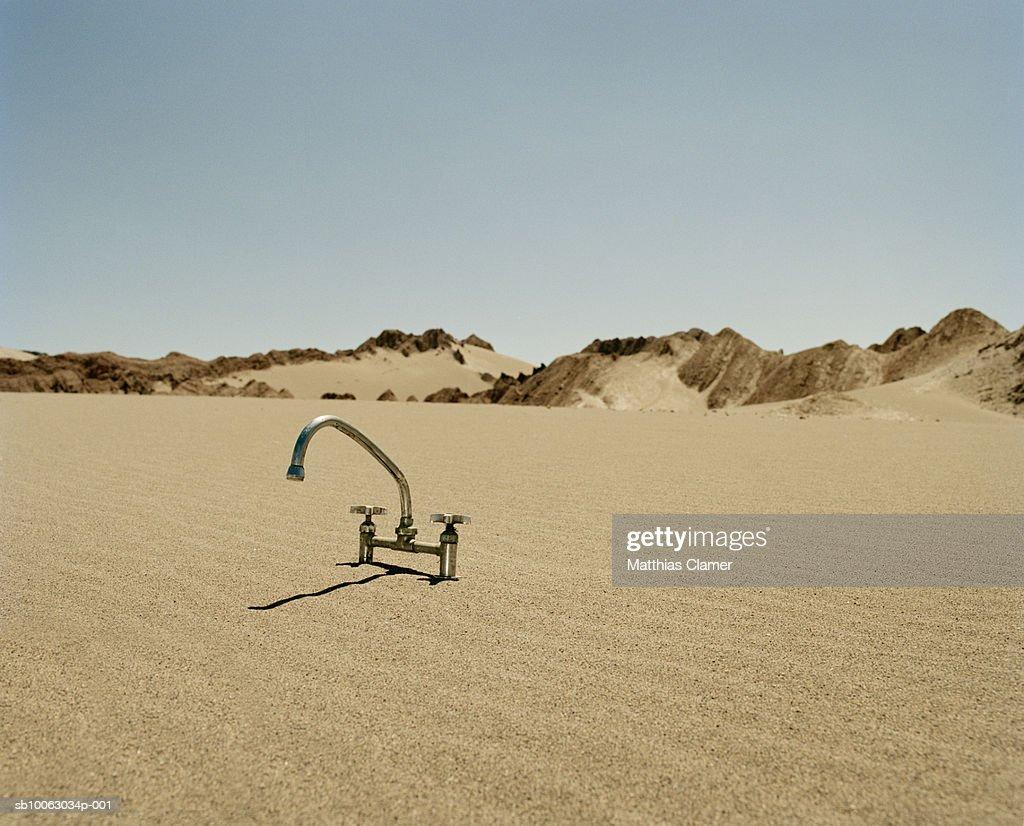 Chile, San Pedro de Atacama, chrome tap in desert : Stock Photo