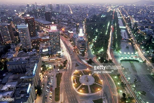 chile, santiago, santiago de chile, alameda and skyline, dusk, aerial - santiago chile stock pictures, royalty-free photos & images