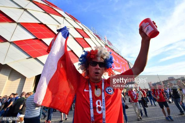 A Chile supporter cheers as he arrives to attend the 2017 Confederations Cup group B football match between Cameroon and Chile at the Spartak Stadium...