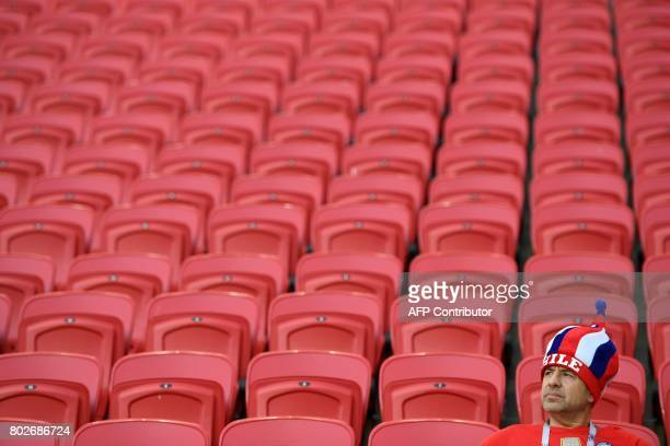 Chile supporter waits in his seat for the start of the 2017 Confederations Cup semifinal football match between Portugal and Chile at the Kazan Arena...