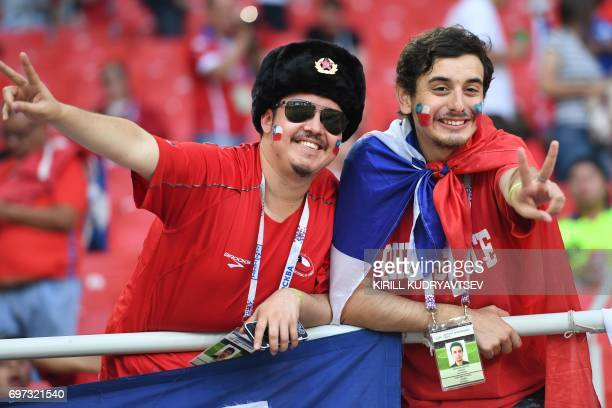 Chile supporters cheer ahead of the 2017 Confederations Cup group B football match between Cameroon and Chile at the Spartak Stadium in Moscow on...
