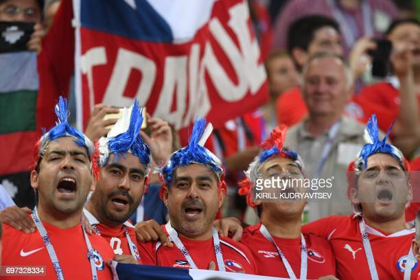 TOPSHOT Chile supporters sing during the 2017 Confederations Cup group B football match between Cameroon and Chile at the Spartak Stadium in Moscow...