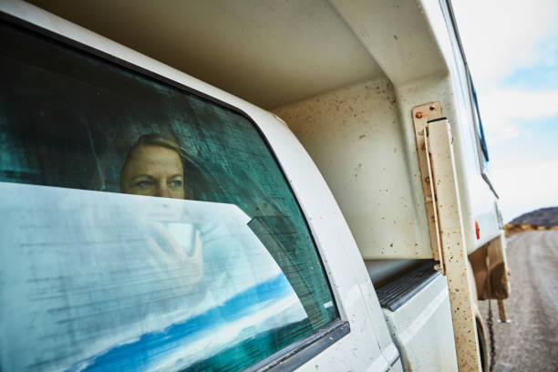 Chile, Valle Chacabuco, Parque Nacional Patagonia, woman looking out of window in camper