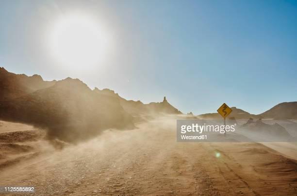 chile, valle de la luna, san pedro de atacama, sand track in sandstorm - 砂漠 ストックフォトと画像