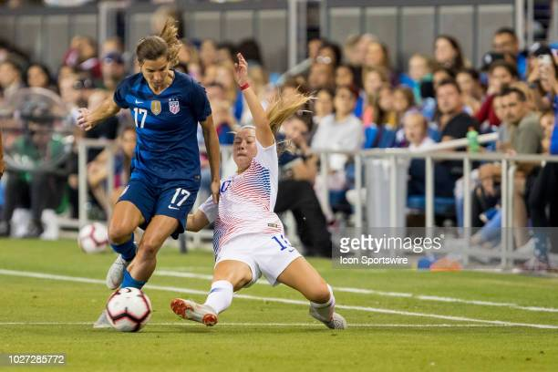 Chile Women's National Football Team Forward Yanara Aedo stretches for a ball around United States Women's National Team Forward Tobin Heath during...