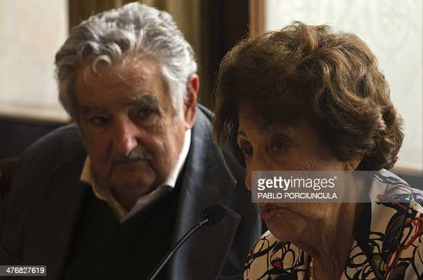 Chilean activist Angela Jeria de Bachelet the mother of Chile's Presidentelect Michelle Bachelet speaks next to Uruguay's President Jose Mujica...
