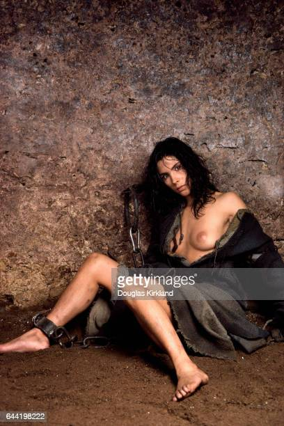 Chilean Actress Valentina Vargas poses topless wearing rags and shackles