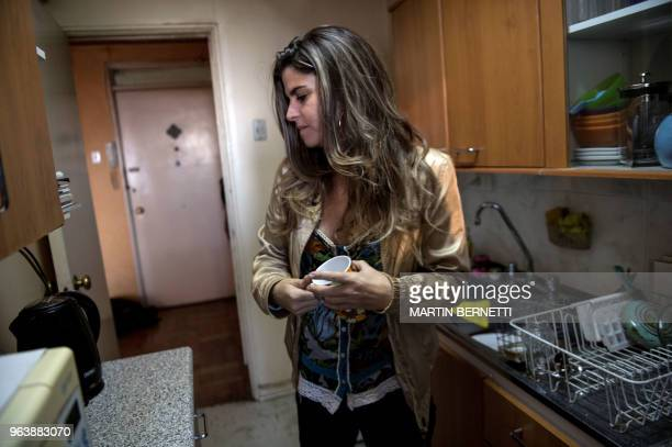 Chilean AIDS patient Carolina Del Real prepares coffee at her home in Santiago on April 27 2018 Carolina was infected with HIV in 2010 Last year...