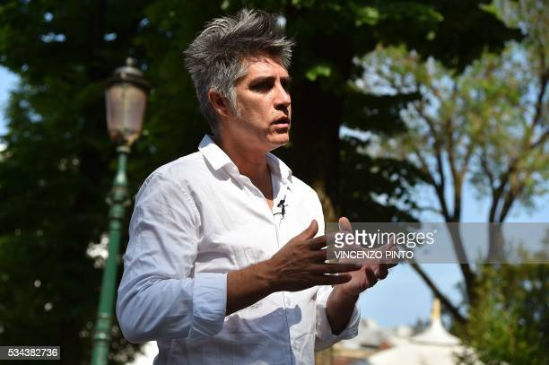 Chilean architect Alejandro Aravena speaks during an interview at the opening of the 15th International Architecture Exhibition in Venice on May 25...