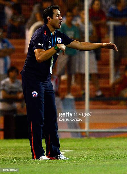 Chilean coach Mario Salas gives instructions to his players during their South American U-20 Championship Group A football match against Argentina,...