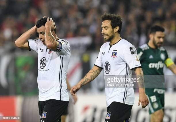Chilean ColoColo Jorge Valdivia and Esteban Paredes react after missing a chance of goal against Brazilian Palmeiras during a Copa Libertadores 2018...