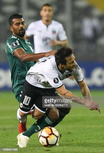 Chilean ColoColo Jorge Valdivia vies for the ball with Brazil's Palmeiras Thiago Santos during a Copa Libertadores 2018 quarterfinal football match...