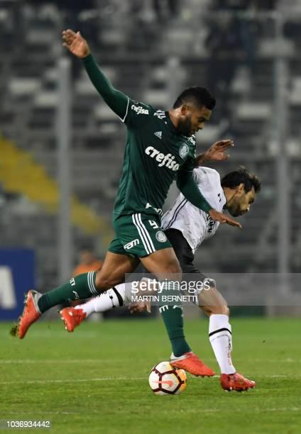 Chilean ColoColo Jorge Valdivia vies for the ball with Brazil's Palmeiras Miguel Borja during a Copa Libertadores 2018 quarterfinal football match at...