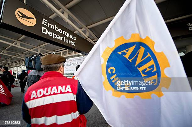 Chilean customs workers demonstrate in front of the Arturo Merino Benitez International Airport in Santiago during a national strike called by the...