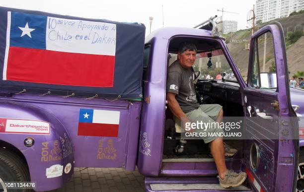 Chilean Dakar fan Gines Pulgar poses in Lima in his 1955 Ford truck on the first day of the Dakar Rally on January 6 2019 This is the tenth time that...