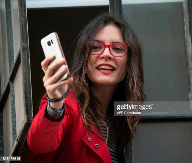 Chilean deputy Camila Vallejo is seen during a rally of Chilean presidential candidate Alejandro Guillier in Santiago on August 4 2017 Guillier a...