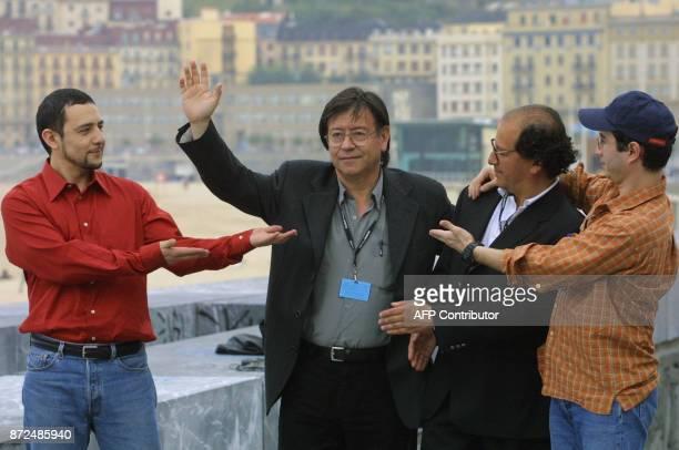 Chilean director Orlando Lubbert waves surrounded by three actors of his movie 'Taxi para tres' Daniel Munoz Alejandro Trejo Fernando GomezRovira...