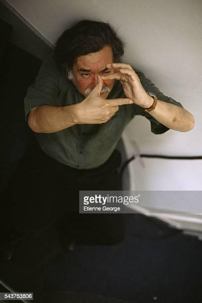 Chilean director Raoul Ruiz on the set of his film 'Três Vidas E Uma Só Morte'