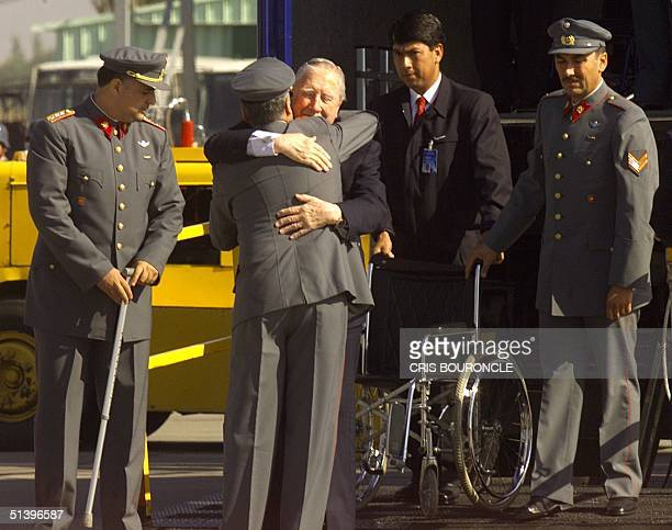 Chilean exdictator Augusto Pinochet embraces a comrade upon arrival in Santiago Chile 03 March 2000 Pinochet left Britain 02 March after British Home...