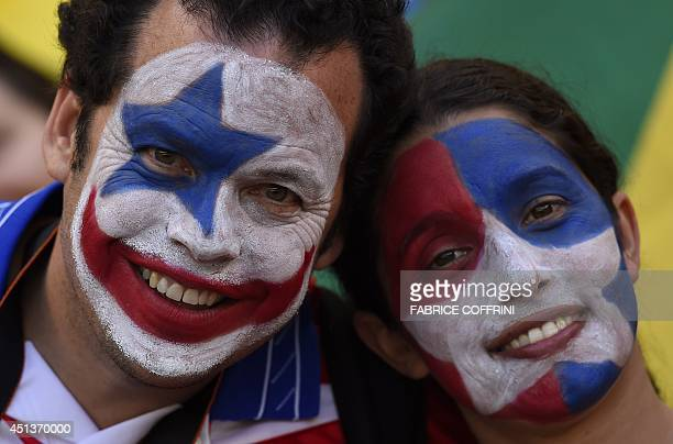 Chilean fans pose before the start of the round of 16 football match between Brazil and Chile at The Mineirao Stadium in Belo Horizonte during the...