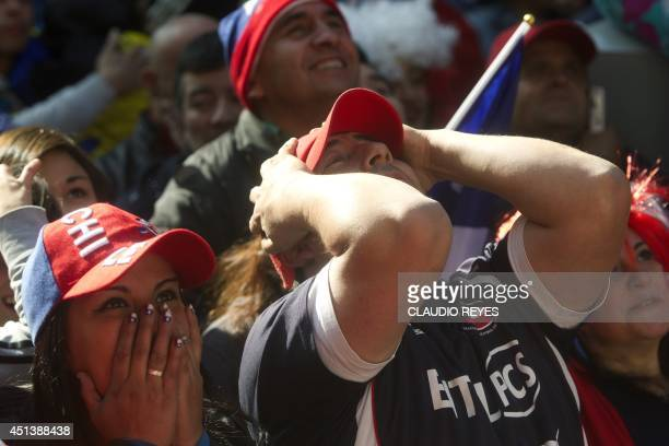 Chilean fans react as they watch the live broadcast of the FIFA World Cup football match against Brazil in Santiago on June 28 2014 AFP PHOTO /...