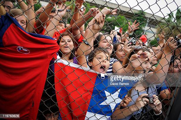 Chilean fans show their support from behind a fence as Alexis Sanchez from Chile is presented as a newly signed player for FC Barcelona at Camp Nou...