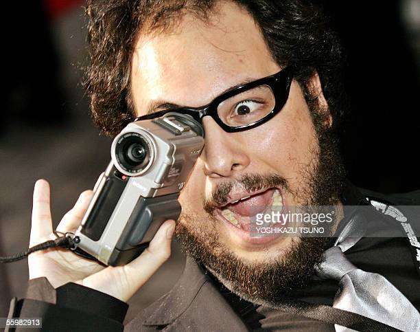 Chilean film director Nicolas Lopez videotapes press photographers with a handy camcorder on the red carpet for the opening ceremony of the 18th...