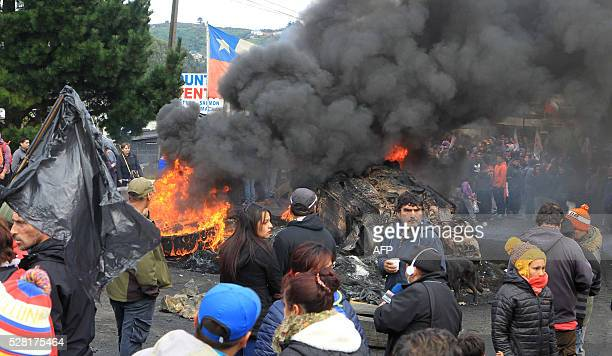 Chilean fishermen protest against the government next to a barricade in Ancud in Chiloe island about 1230 km south of Santiago on May 4 2016...