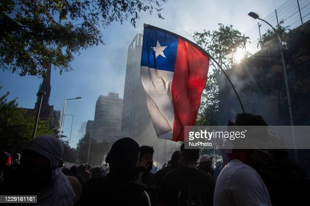 Chilean flag in the midst of commemoration, demonstration and protest of the first anniversary since the beginning of the social outbreak in Chile....