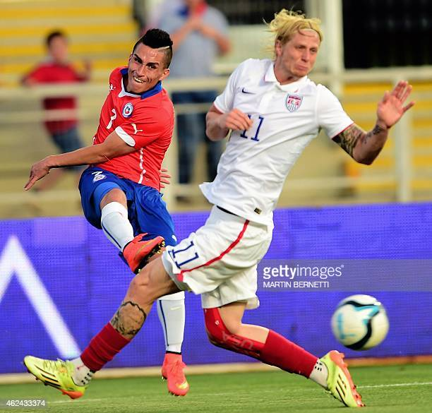 Chilean footballer Bryan Carrasco vies forthe ball with US Brek Shea during a friendly football match at the El Teniente Stadium in Rancagua some 80...