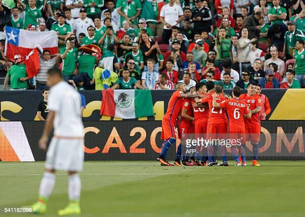 Chilean footballers celebrate after scoring against Mexico during the Copa America Centenario quarterfinal football match in Santa Clara California...
