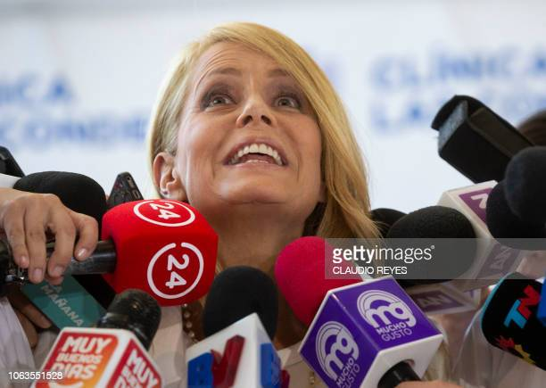 Chilean former Miss Universe and exwife of former Argentine president Carlos Menem Cecilia Bolocco delivers a press conference at Las Condes clinic...
