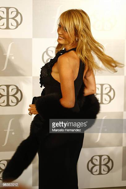 Chilean former Miss Universe Cecilia Bolocco poses for photographers during her fashion show on April 8 2010 in Santiago Chile Bolocco began...