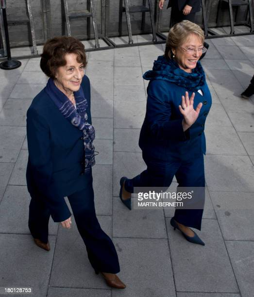 Chilean former president Michelle Bachelet and her mother Angela Jeria participate in a ceremony at the Memory Museum in Santiago on September 9 2013...